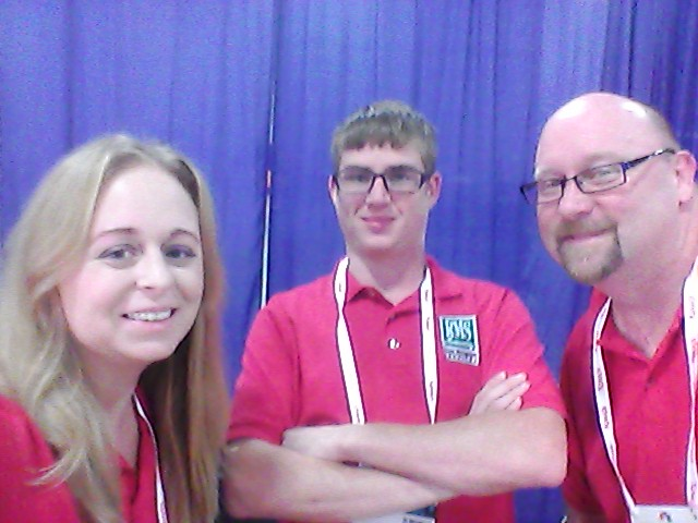 Employees at Trade Show, Andrea, Jacob & Roger